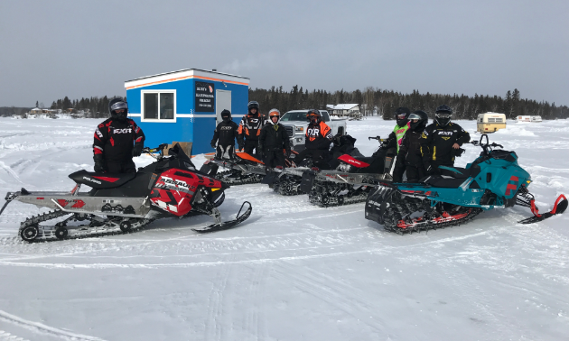 A group of Flin Flon riders gather at a checkpoint on Trail 400 at the recent Frozen Aces Poker Derby.