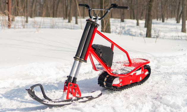 A red electric snow scooter.