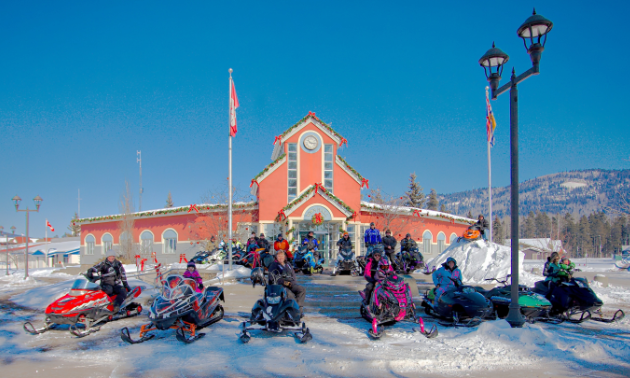 On a cold day late in winter, a group of sledders gathered at the Tumbler Ridge Town Hall to celebrate their SledTown ShowDown victory to recreate a 20-year-old photo.