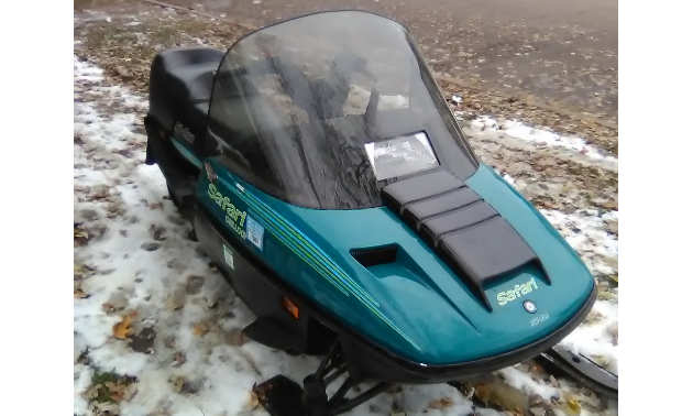 A turquoise 94 Safari snowmobile.