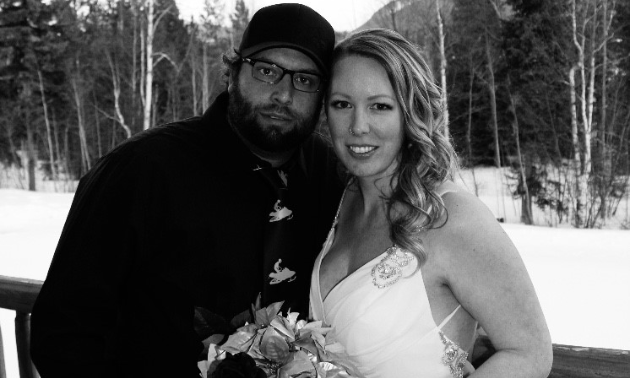 Mitch and Angie Lepage lean in to each other in a black and white photo.