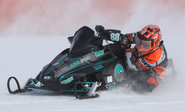 Brennan Boxall leans into a turn during an ice oval race.