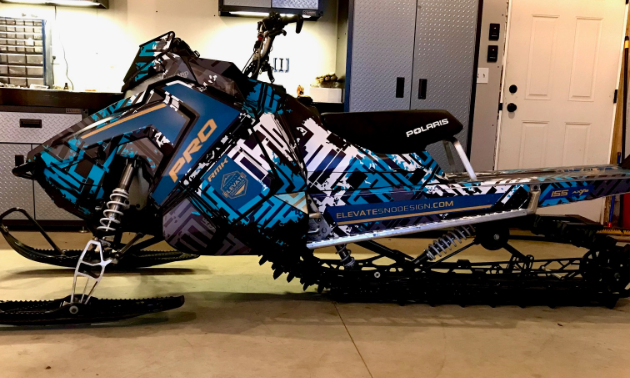A black and blue snowmobile.