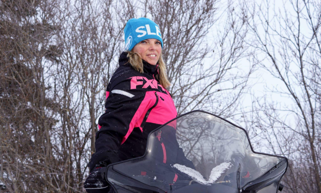Charlene Isfeld poses on her snowmobile.