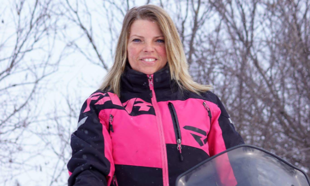 Charlene Isfeld stands out against a white backdrop by wearing pink.
