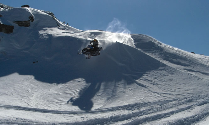 At Beaver Creek near Chetwynd, B.C., Fred Wiebe takes a jump off a snowy bank for a soft landing in the powder below.