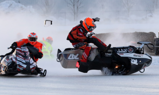 Snowmobile racer Jordan Wahl is jettisoned from his snowmobile during a spectacular crash.