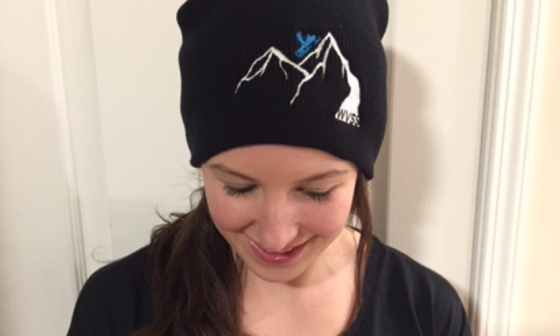 Gary Prosser's daughter sports a toque with the Windermere Valley Snowmobile Society's new logo.