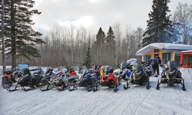 The Dauphin & District Snowmobile Club prepares for a club ride.