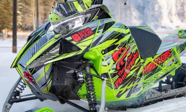 A neon green snowmobile.