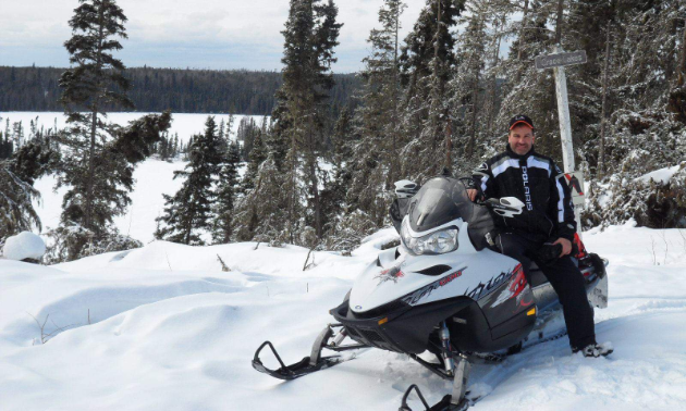 Trevor Schell poses on his snowmobile in Smeaton, Saskatchewan
