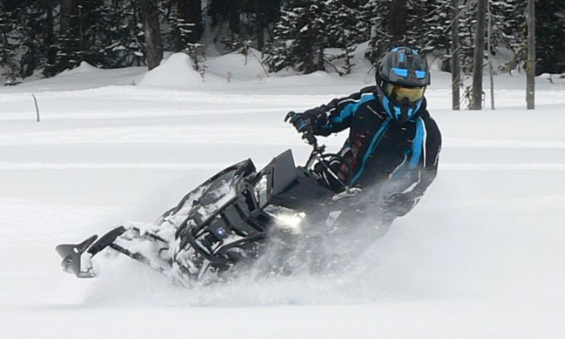 Jan DeRepentigny rides her 2017 800 Polaris Pro in the snow.