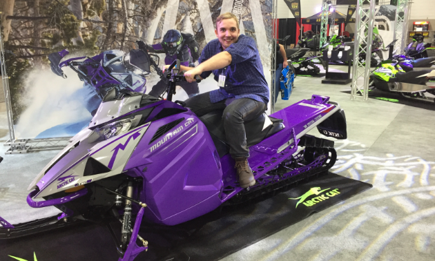 Jason Woods, advertising consultant for SnoRiders magazine, took an Arctic Cat for an imaginary test drive on the show floor of the 2018 annual Alberta Snowmobile and Powersports Show.
