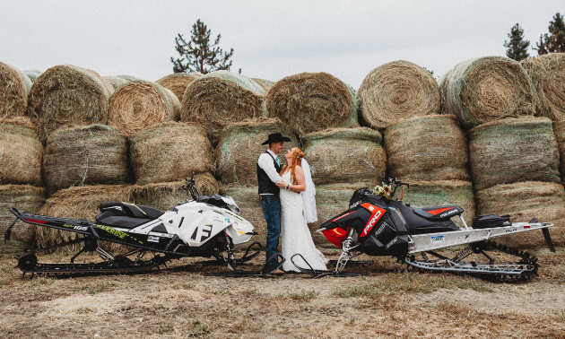Justin Evans and Kyra Casorso have no trouble showcasing their passion for snowmobiling.