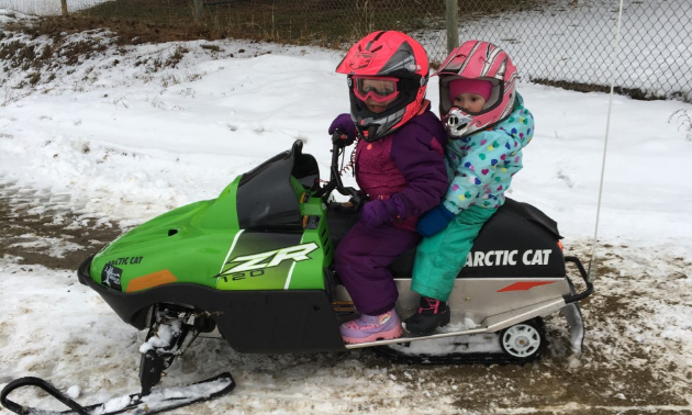 """Let's go, Dad!"" Paisley and Brooklyn are ready for another snowmobiling adventure."