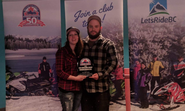 Drew and Liane Leger pose with their Outstanding Snowmobile Family award at the 2019 British Columbia Snowmobile Federation Excellence Awards.