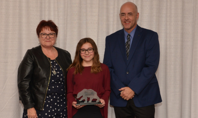 Morgan Nelson received the ASA Excellence Award for Outstanding Youth Contribution Towards the Continued Development of Family Snowmobiling on October 13, 2018.