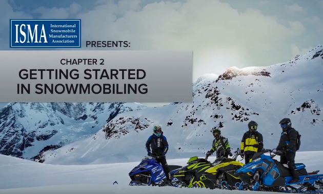 Snowmobilers converse before heading out for a trip.