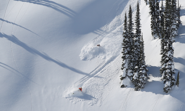 Rene St. Onge and a friend make fresh tracks.