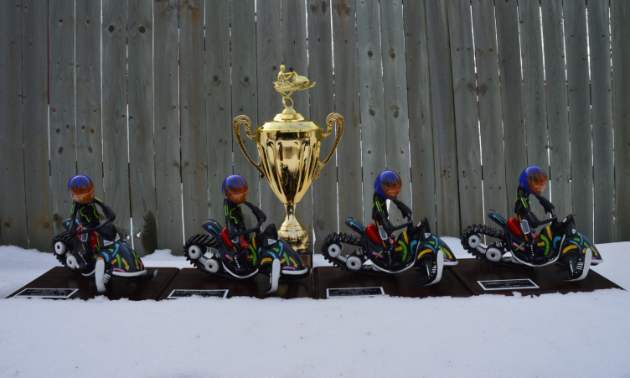 SledTown ShowDown trophies sit in the snow