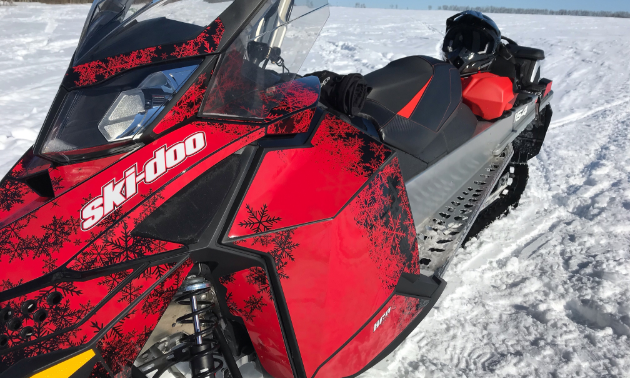 A 2017 Summit 800 ruby red sled on the Thickwood Trails in Saskatchewan.