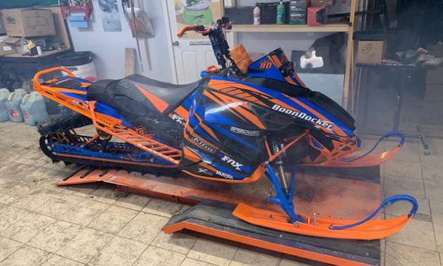 A blue and orange snowmobile.