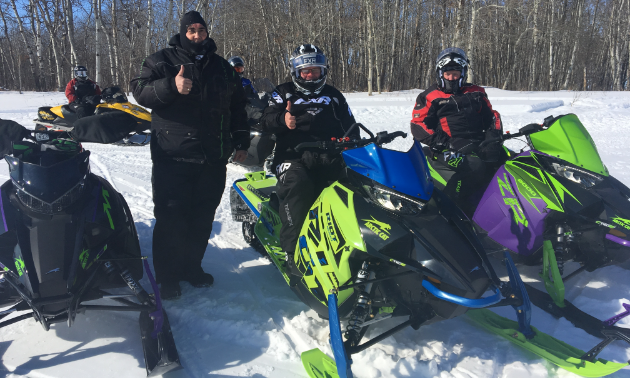 (On left) Stan Langley stands next to an Arctic Cat Riot, Arctic Cat 8000 and Arctic Cat Alpha.