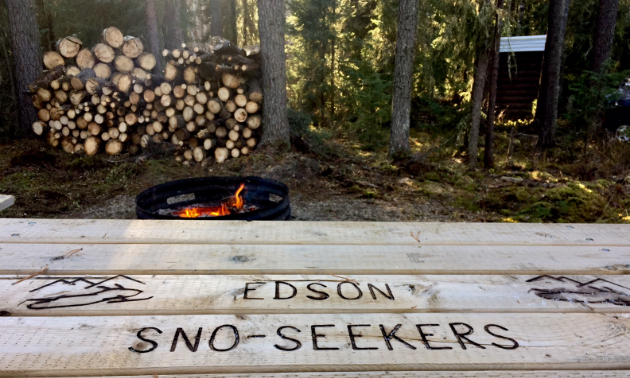 A picnic table with Edson Sno Seekers printed into the wood.