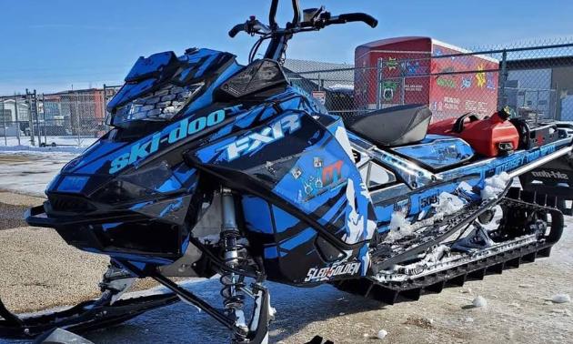 A blue and black 2019 Ski-Doo Summit 850 165 snowmobile.