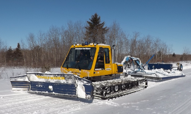 Barry Malcolm rides a 1999 BR275 plus, pulling a 12- by 25-foot Mogul Master in Beausejour, Manitoba, for the Brokenhead Trailblazers.