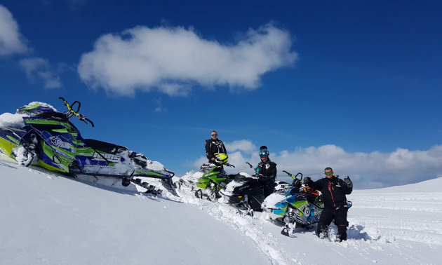 (L to R) Curtis Anderson, Marshall Dempster and Danny Roberts, photographer for Boosted Imagery, take a moment to chill on their eventful day sledding in the backcountry.