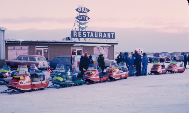 Snowmobile riders line up for the Manitoba Centennial