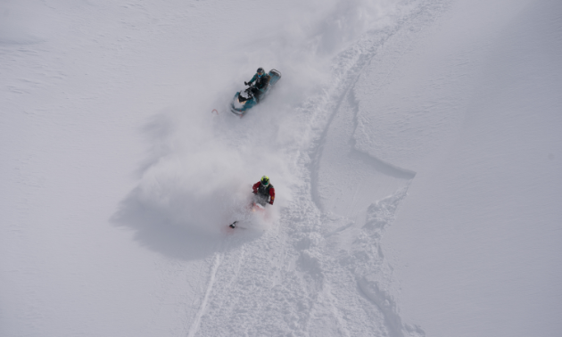This bird's-eye view shows off Curtis Pawliuk (red) and Marshall Dempster (teal) cutting through fresh powder.