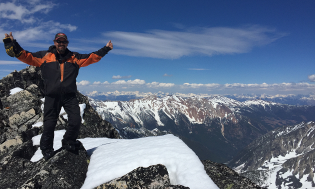 Dean Ingram stands proudly on top of a mountain near Radium.