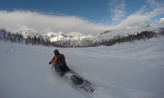 Dean Ingram sleds down a mountain in Radium.