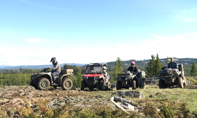 ATVers take a break on their ATVs