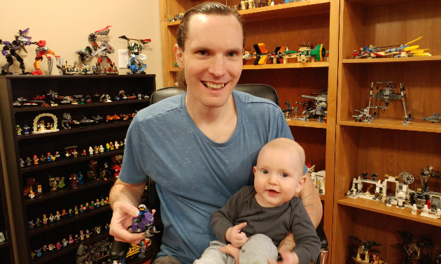 Kyle and Augustus Born smile while playing in the Lego room