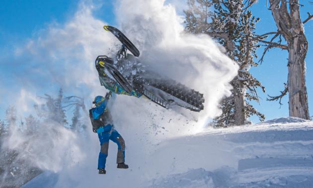 Logan Thibodeau flies his snowmobile above his head