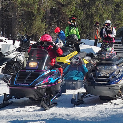 Snowmobilers waiting to head off down the trail.