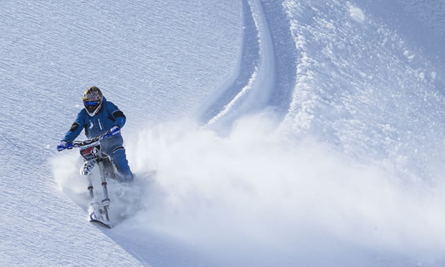 Cory Derpak sidehilling on the Yeti snow bike in Alaska.