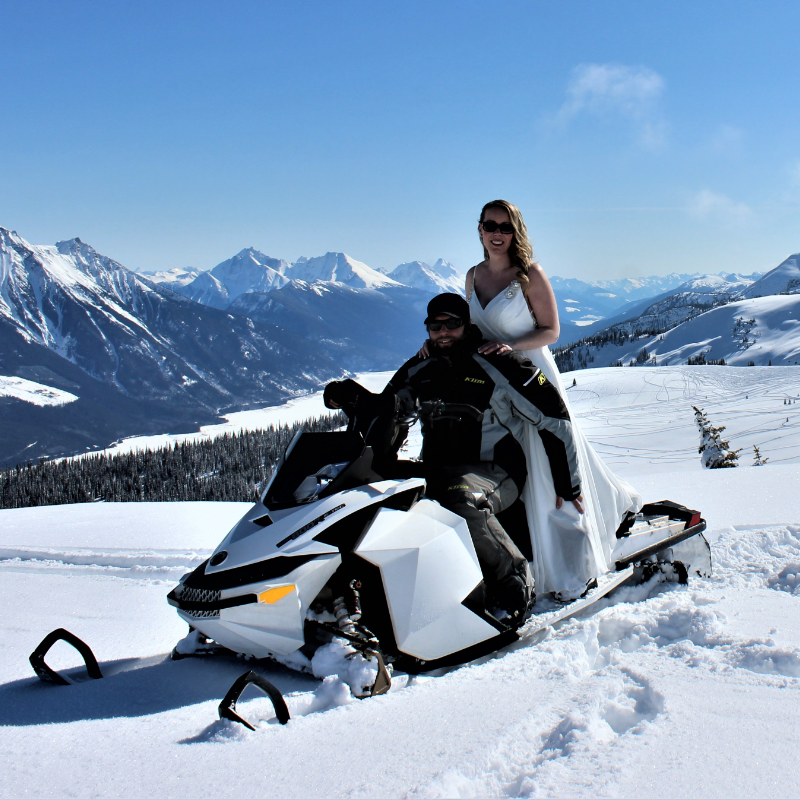 Mitch and Angie Lepage sit on a 2012 Ski-Doo Freeride for their wedding at Clemina in Valemount, B.C.