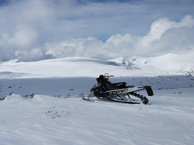 A snowmobile overlooking the Telkwa Range in Houston, B.C.