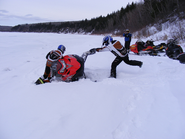 A sled tipped over on the Saskatchewan River.