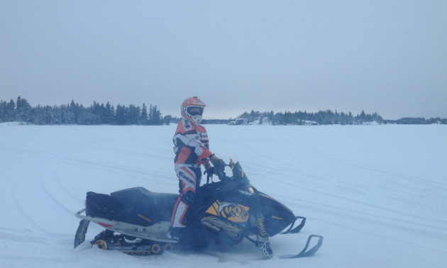 Ashley Erickson snowmobiling on Whiteshell's trails