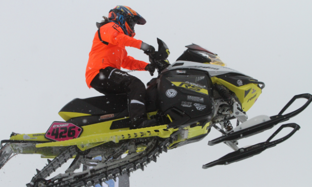 Ashley Chaffin in mid-air on her snowmobile.