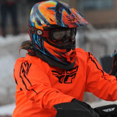 Ashley Erickson in her bright orange sledding outfit