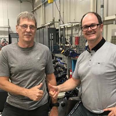 Berthold Fecteau pictured (left) with Sebastien Thibault, Race & Engine Calibration Manager.