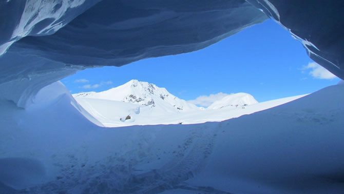 A view from inside one of the snow caves that riders can find along Blue River's