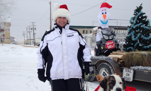 Brenda and her reindog, Patches, get ready to hand out candy at the Santa Claus Parade.
