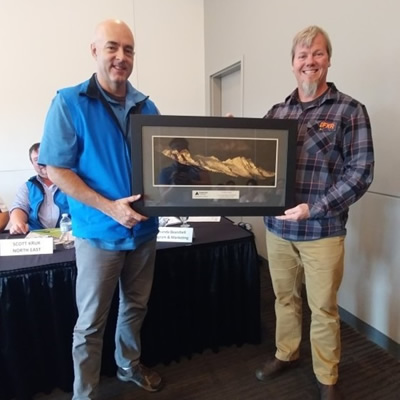 Chris Brookes from the Alberta Snowmobile Association accepts the annual service award from Avalanche Canada. The award was presented during the Alberta Snowmobile Association's annual general meeting.